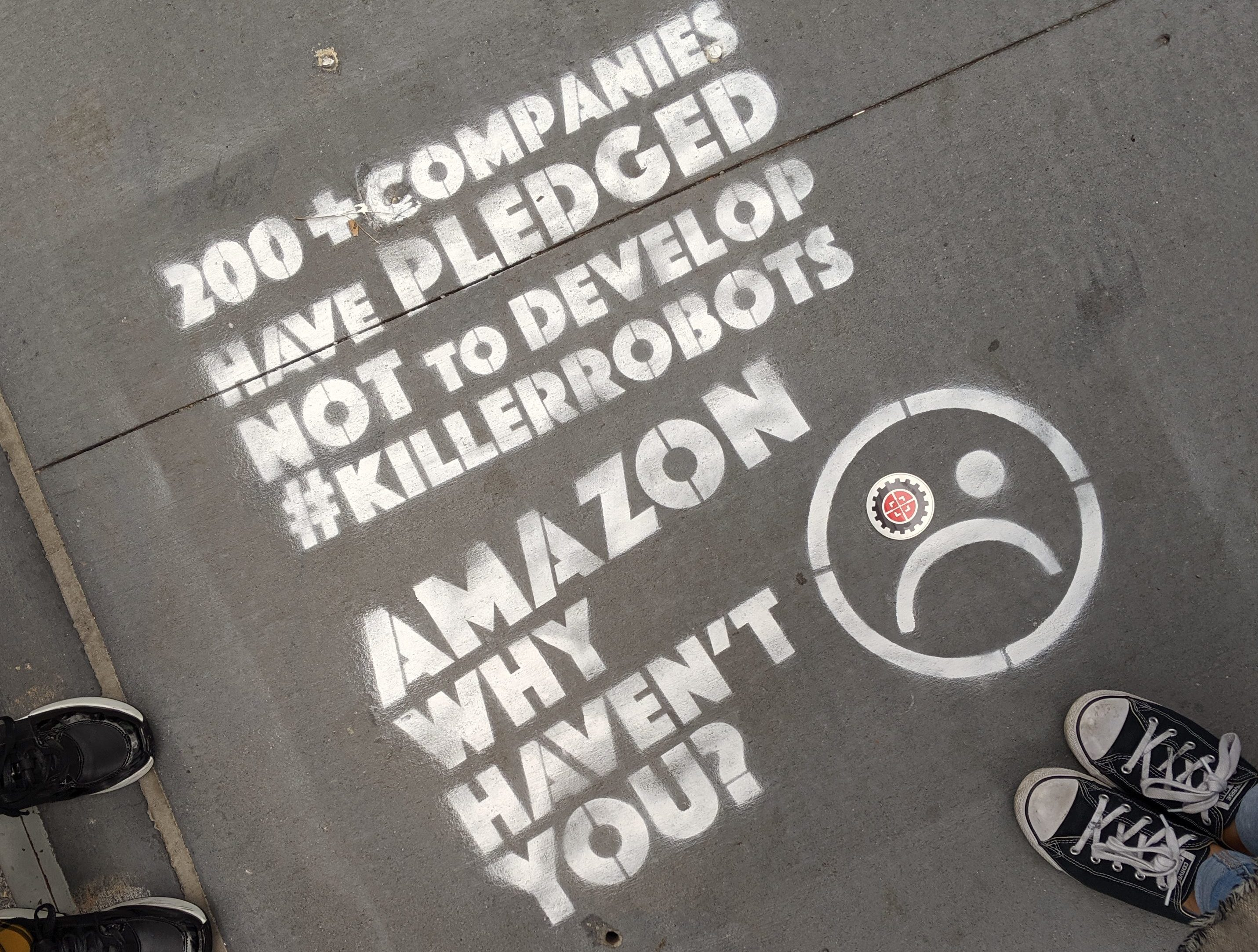 Street graffiti asks Amazon to pledge to not develop killer robots.